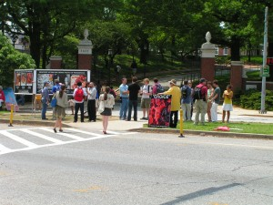 "A crowd gathers in front of GAP and CBR's ""Choice"" signs at Johns Hopkins University."