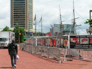 The masts of the USS Constellation rise above the GAP signs.