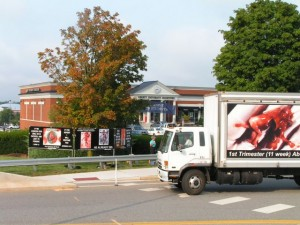 Trucks and signs at Liberty University Bookstore.