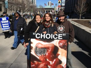 "Abortion photos let HKonJ marchers see for themselves that ""No evil is ever necessary. Evil is a choice."""