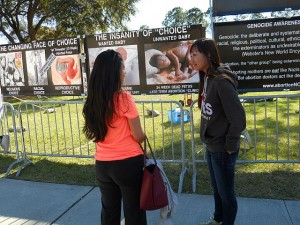 CCBR volunteer Mingy Xu (right) from Ontario talking one on one with a student at North Florida University.