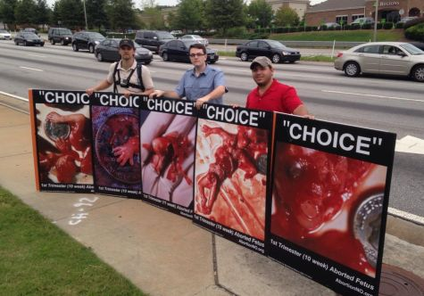 A post-abortive stranger encouraged us to keep showing these images