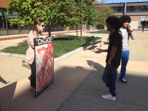 "Cristina Lauria displays a ""Choice"" sign at the U at Buffalo."